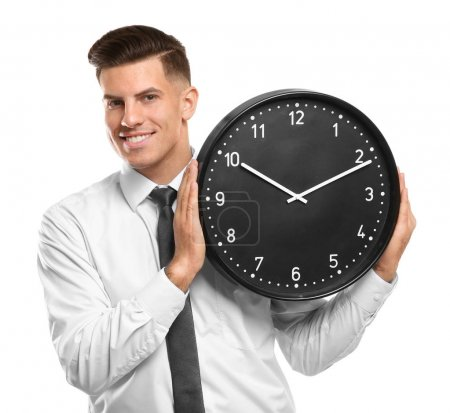 Handsome manager with clock on white background