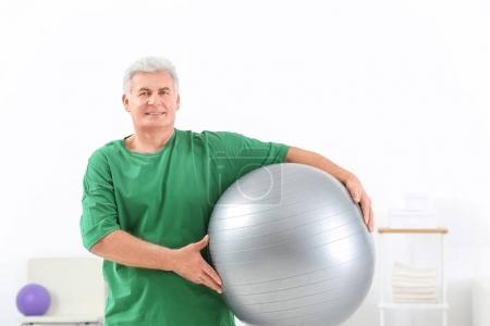 Senior man with fitball