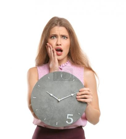 Shocked manager with clock on white background