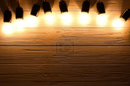 Photo for Festive Christmas lights on wooden background - Royalty Free Image