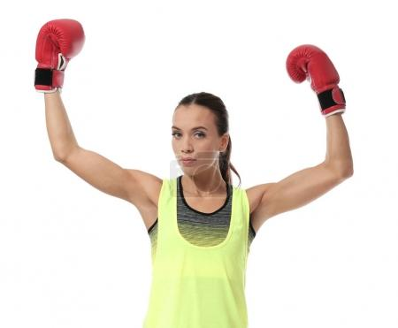 Strong woman in boxing gloves on white background
