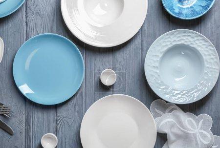 Ceramic tableware on wooden background