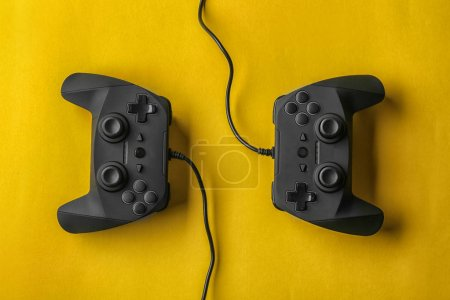 Photo for Video game controllers on color background - Royalty Free Image