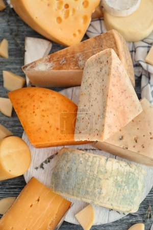 Variety of cheese on wooden background