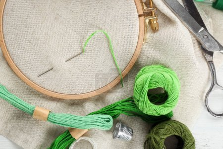 Threads and other accessories for embroidery on table