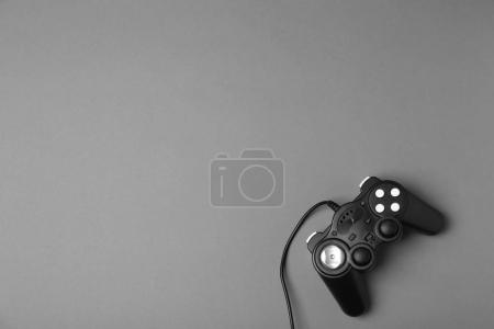 Video game controller on grey background