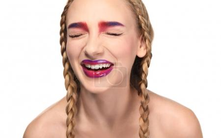 Young woman with dyed eyebrows on white background