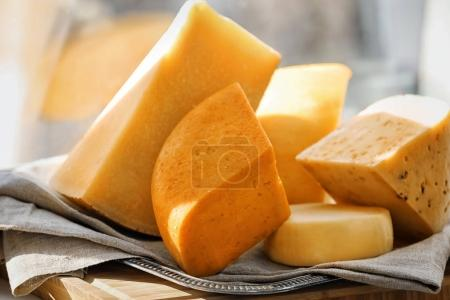 Sliced assorted cheese on windowsill