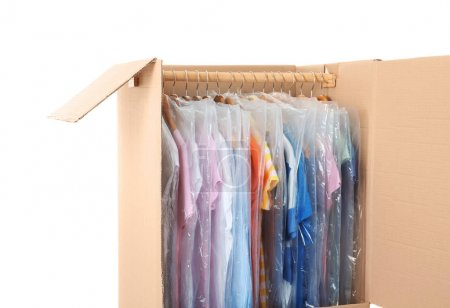 Wardrobe box with clothes on white background
