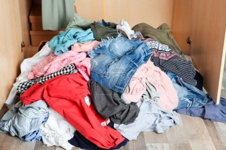 Pile of clothes on floor indoors