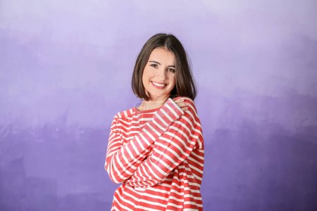 Young smiling woman on color background