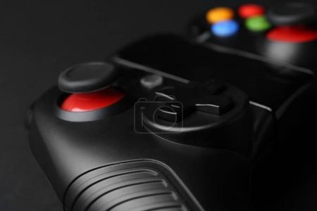 Video game controller on dark background, closeup