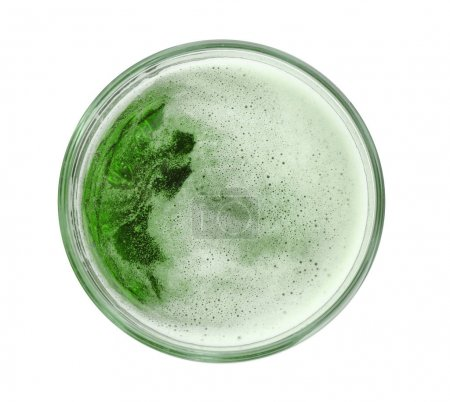 Glass of green beer on white background. Saint Patrick's day celebration