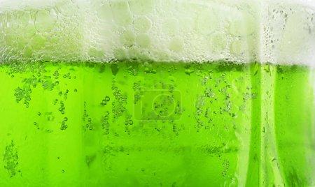 Glass of green beer, closeup. Saint Patrick's day celebration