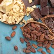 Different cocoa products on wooden background, top...