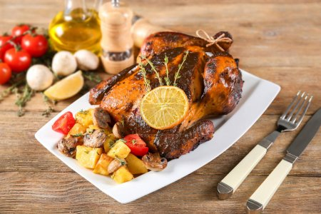 Delicious whole roasted chicken served on plate