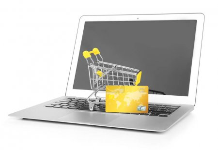 Laptop with small shopping trolley and credit card on white background. Internet shopping concept