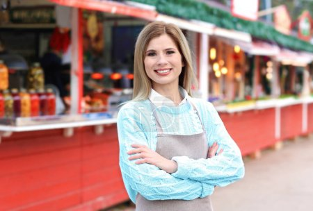 Business owner near her counter, outdoors