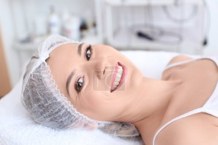 Young woman at beauty salon. Cosmetic procedures
