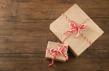 Photo for Parcel gift boxes on wooden table - Royalty Free Image