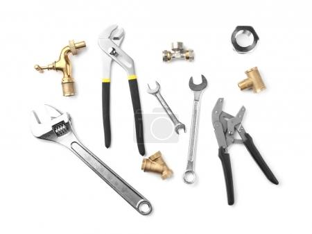 Plumber's items on white background