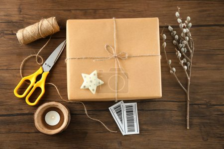 Composition with parcel gift box on wooden background