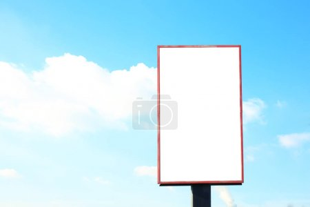 Photo for Blank advertising board outdoors against blue sky - Royalty Free Image