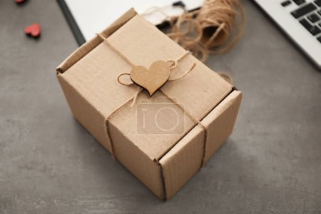 Preparing parcel for shipment to customer on table in home office. Startup business