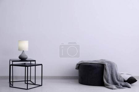 Photo for Living room interior with elegant table and pouf near wall - Royalty Free Image