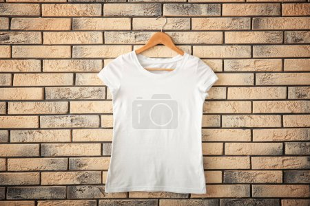 White t-shirt on brick wall background. Mockup for design