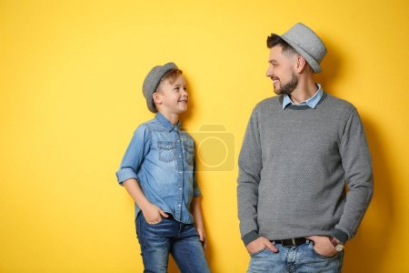 Photo for Stylish father and son on color background - Royalty Free Image