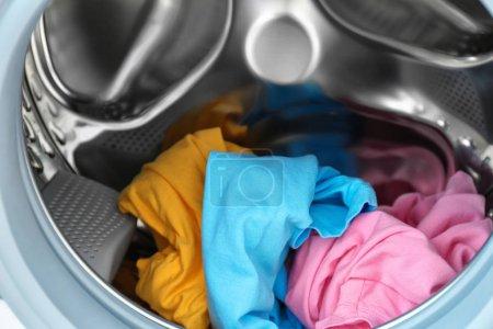 Laundry in washing machine, closeup