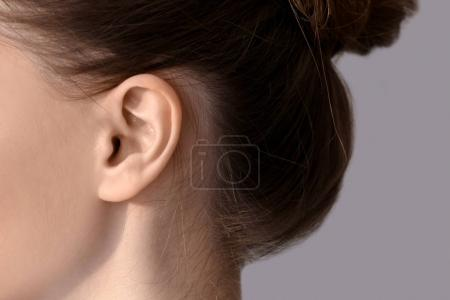 Photo for Young woman with hearing problem, closeup - Royalty Free Image