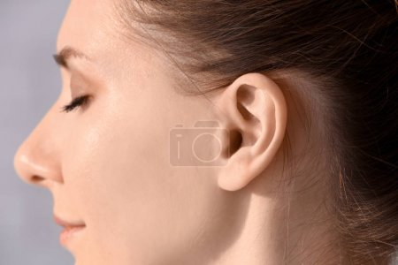 Young woman with hearing problem, closeup