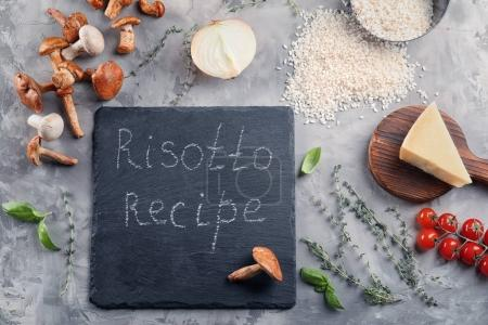 Composition with ingredients for risotto on table