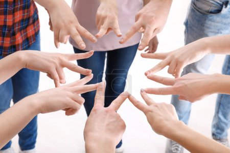 Young people putting hands together as symbol of unity