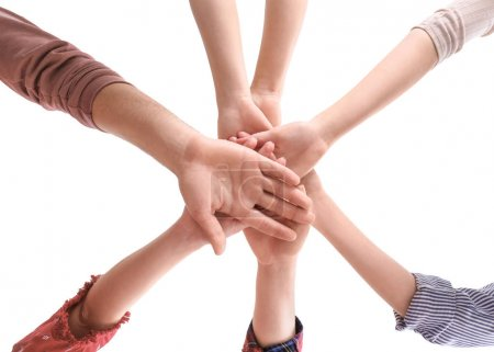 Photo for Young people putting hands together as symbol of unity, on white background - Royalty Free Image