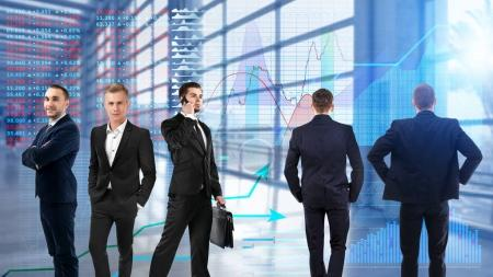 Team of brokers and stock exchange quotes on background