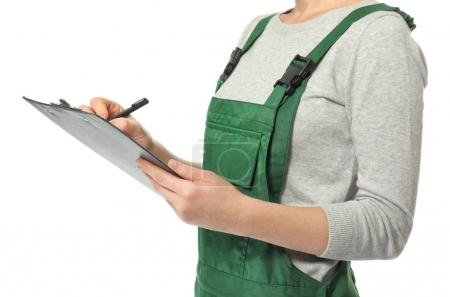 Female auto mechanic with clipboard and pen on white background, closeup
