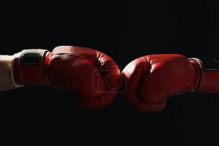 Men in boxing gloves on black