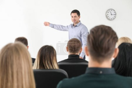 Photo for Group of people with business trainer at management seminar - Royalty Free Image