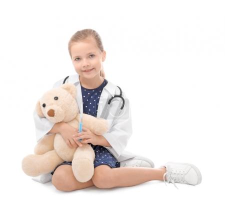 little girl in doctor uniform