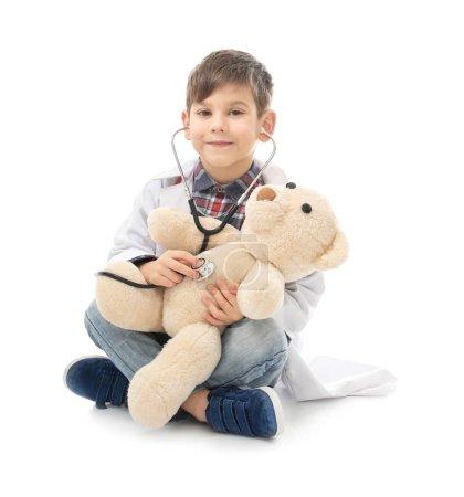 little boy in doctor uniform
