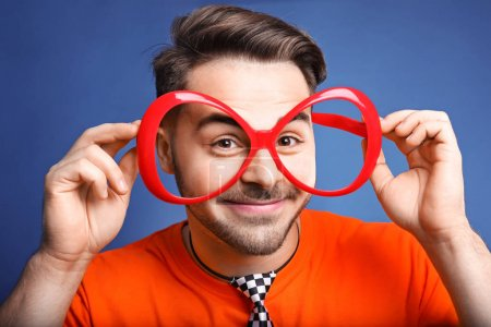 Young man in funny glasses
