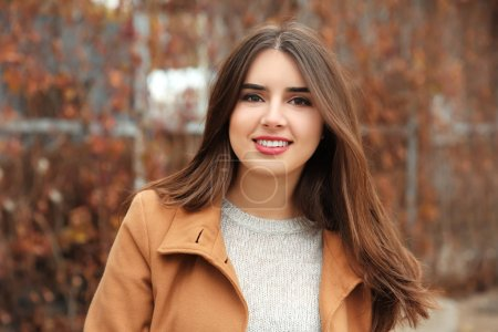 Photo for Beautiful smiling woman outdoors - Royalty Free Image