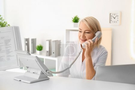 Female receptionist working in hospital
