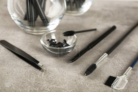 Set of tools for eyebrow dyeing and correction on table