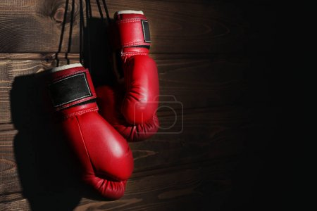 Boxing gloves on wooden