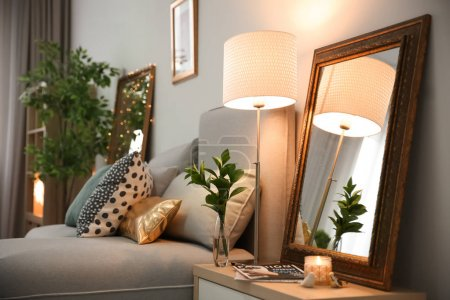 Photo for Elegant room interior with mirror on nightstand - Royalty Free Image