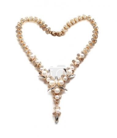 Beautiful necklace with pearls on white background